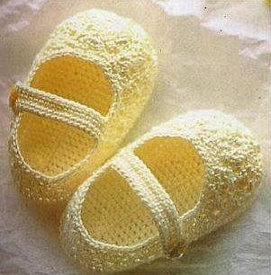 immagine scarpine per neonato all'uncinetto.jpg