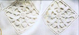 Candidi inserti a rombi con motivi floreali impreziosiscono la semplice tendina in bisso di lino bianco.